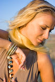Close-up of a fashion model. Close-up portrait of a young blonde woman with bracelet on hand Stock Photography