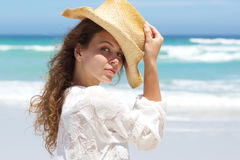 Close up fashion model with hat posing at the beach. Close up portrait of an fashion model with hat posing at the beach Royalty Free Stock Photography