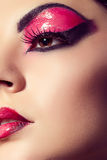 Close up fashion model portrait. Scarlet makeup. Black arrows. Royalty Free Stock Photo
