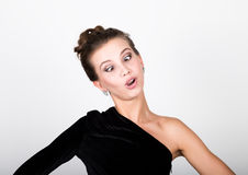 Close-up fashion photo young lady in elegant black dress, playful woman smiles and makes faces Stock Photography