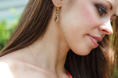 Close up fashion portrait of a beautiful woman with earings Royalty Free Stock Image