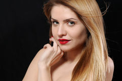 Close up fashion portrait of beautiful young blonde woman on bla Stock Photography