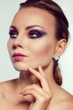 Close up fashion portrait. Model shooting. Purple makeup. stock images