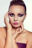 Close up fashion portrait. Model shooting. Purple makeup. Stock Photography