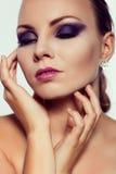 Close up fashion portrait. Model shooting. Purple makeup. stock image