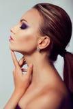 Close up fashion portrait. Model shooting. Purple makeup. royalty free stock photos