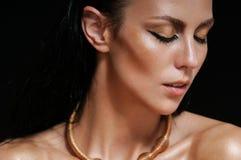 Close up fashion portrait of shining glamourous woman on black b Stock Photo