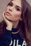 Close up fashion portrait of young beautiful woman. Model shooting royalty free stock photography