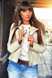 Close up fashion street stile portrait of pretty woman in fall casual outfit. Stock Photography