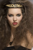 Close-up of fashion wild lady. Close-up fashion portrait of sensual girl with creative curly brown hair-style, leopard accessory and necklace and cute make-up Stock Image
