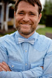 Close up of a fashionable smiling man with bow tie Royalty Free Stock Photos