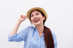 Close up fashionable young woman smiling with hand to hat Royalty Free Stock Images