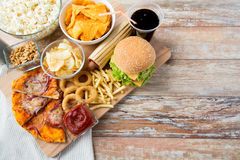 Close up of fast food snacks and drink on table Stock Photography