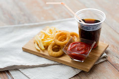 Close up of fast food snacks and drink on table Stock Image