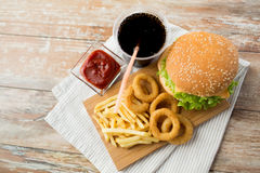 Close up of fast food snacks and drink on table Royalty Free Stock Photo