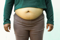 Close-up of fat woman on white background. Concept for obesity issue, diet of food for health Royalty Free Stock Photos