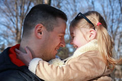 Close Up of Father and Daughter Together Outdoors Stock Photo