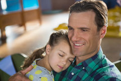 Close-up of father embracing his daughter Stock Photography