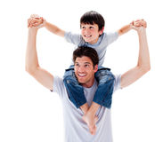 Close-up of father giving his son piggyback ride Royalty Free Stock Photography