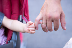 Close up of father holding his daughter hand, so sweet,family time. Close up of father holding his daughter hand,,family time Royalty Free Stock Photo