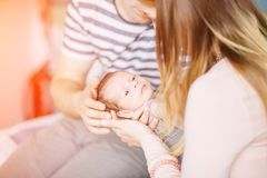 Close up father holding his newborn son stock photo