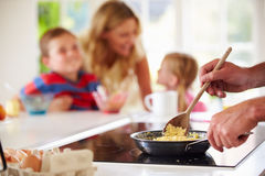 Close Up Of Father Preparing Family Breakfast In Kitchen. Cooking Scramble Egg Royalty Free Stock Images