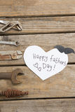 Close up of fathers day text by work tools. On wooden table Stock Photo