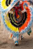 Close Up of a Feather and Quill Bead Bustle Worn at a Pow Wow. Close up of an orange, yellow, blue and white feather and multicolored quill bead bustle worn by a royalty free stock photo