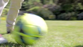 Close Up Of Feet As Grandfather And Grandson Play Football stock video