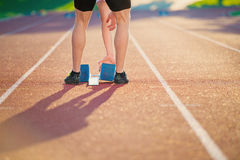 Close-up of feet of an athlete on a starting block about to run.  Royalty Free Stock Photography