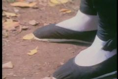 Close-up of feet in Chinese slippers practicing martial arts moves stock footage