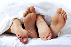 Close-up of the feet of a couple Royalty Free Stock Photo
