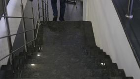 Close up of feet going down on stairs.  stock footage