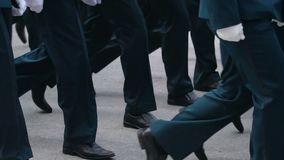 Legs on the March of the Military. A close-up of the feet of military men who march on the parade on May 9, 2018 in a slow motion shot. Same clothes and shoes stock footage