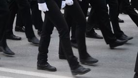 Foot on the March of the Military. A close-up of the feet of military men who march on the parade on May 9, 2018 in a slow motion shot. Same clothes and shoes stock footage