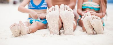 Close-up of the feet of mother and two daughters Royalty Free Stock Photo