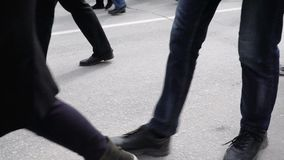 Legs are Coming. Close-up of the feet of people in motion. Different shoes on the legs closeup. People in the crowd. Man is in a hurry to work. Hopeless stroll stock video footage