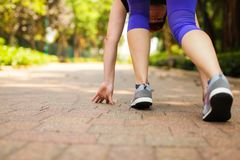 Close up of feet of runner running in park training for marathon and fitness healthy lifestyle. Selective focus royalty free stock images