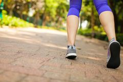 Close up of feet of runner running in park training for marathon and fitness healthy lifestyle. Selective focus royalty free stock image