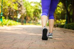Close up of feet of runner running in park training for marathon and fitness healthy lifestyle. Selective focus royalty free stock photos