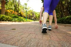 Close up of feet of runner running in park training for marathon and fitness healthy lifestyle. Selective focus royalty free stock photo