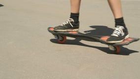 Close-up of feet of skateboarder boy on skateboard stock footage