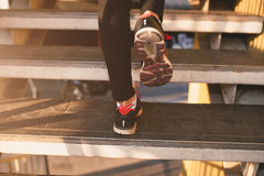 Close up of feet with sneakers climbing up the stairs Royalty Free Stock Images