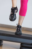 Close up of feet in step equipment Stock Images