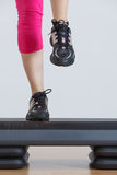 Close up of feet in step equipment Royalty Free Stock Photography