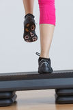 Close up of feet in step equipment Royalty Free Stock Photos