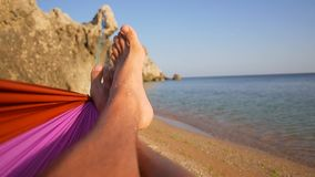 Close Up Feet Swinging in a Hammock on the Beach. 1920x1080 Slowmotion. stock footage