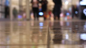 Close-up feet walking people in the mall stock footage