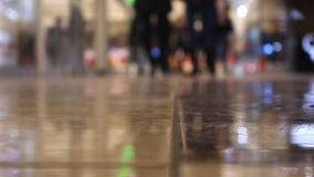 Close-up feet walking people in the mall stock video footage
