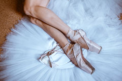 The close-up feet of young ballerina in pointe shoes royalty free stock images